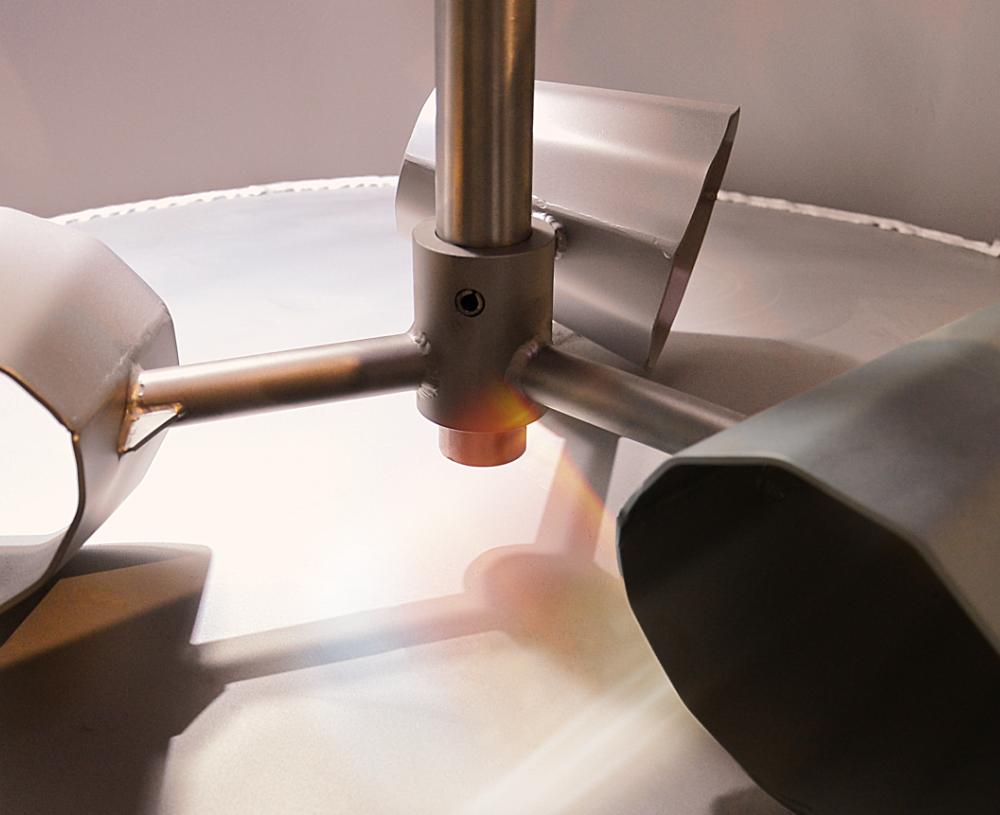 Drei Becher aus Edelstahl horizontal um 120 Grad versetzt befestigt an einem zentralen Rundstab in Bewegung.