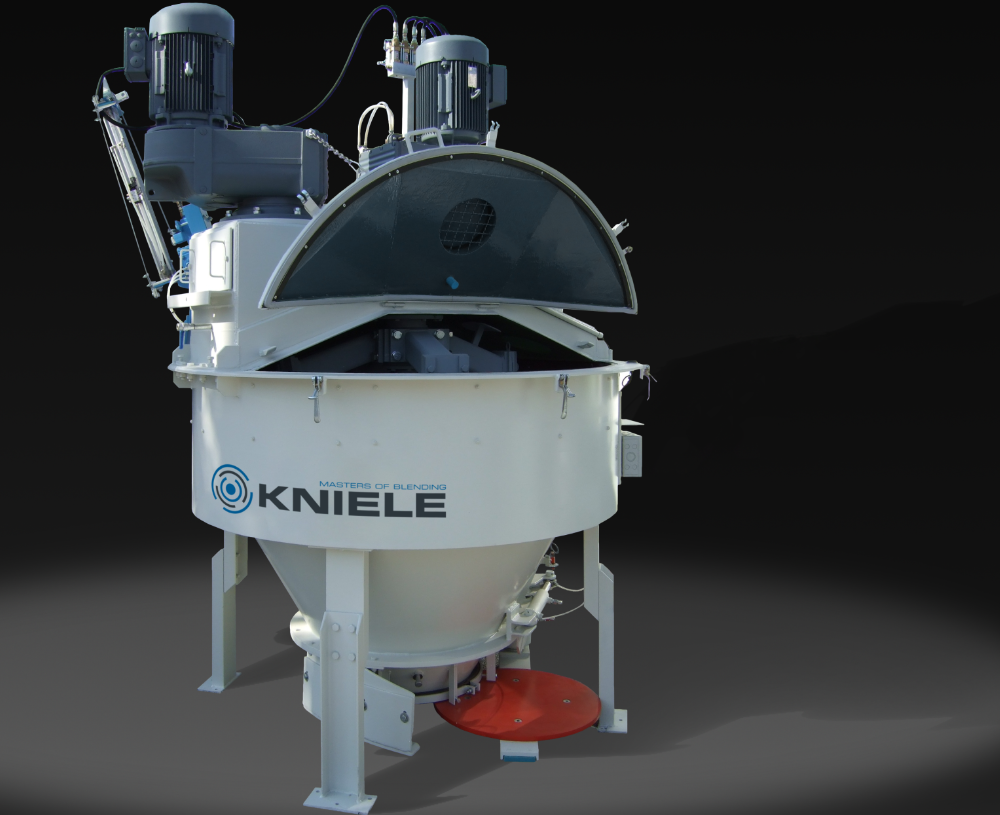 White Kniele cone mixer for concrete with two attached motors and open mixer cover.